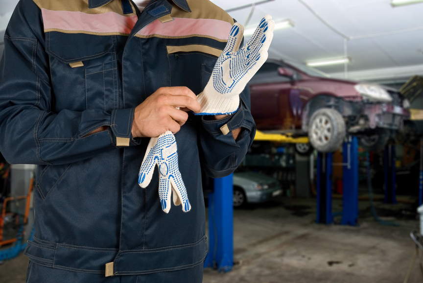 auto mechanic putting on glove